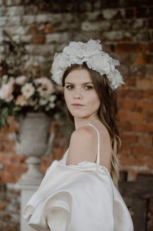Beautiful Bride in Ruffle Headdress and Puffed Sleeve Wedding Dress
