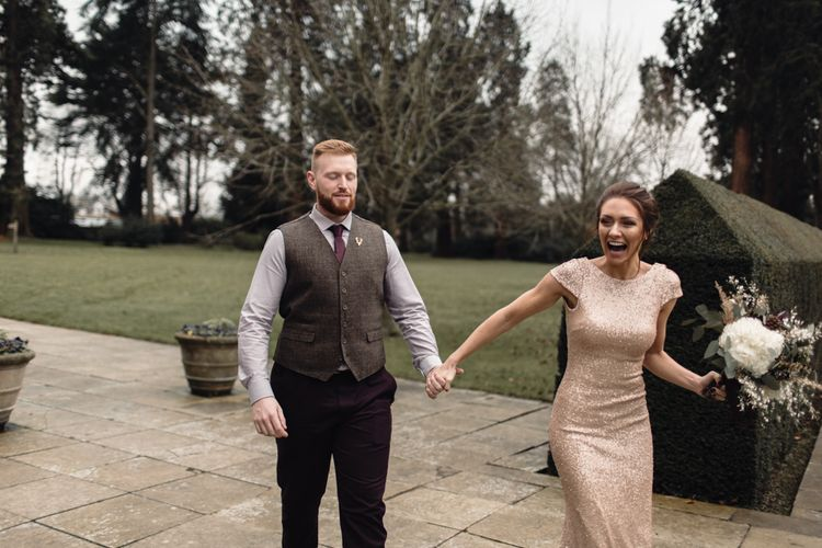 Bridesmaids Walking With Groom For 'First Look' At The Bride // Bride In Alice Dress By Watters // Christmas Pub Wedding At The Falcon Rotherwick With Bride In Alice By Watters And Candle Lit Wedding Ceremony Images By Rebecca Searle Photography