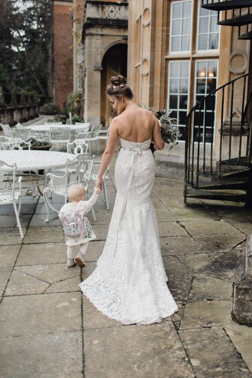 Bride In Alice By Watters With Daughter In Zara Baby // Christmas Pub Wedding At The Falcon Rotherwick With Bride In Alice By Watters And Candle Lit Wedding Ceremony Images By Rebecca Searle Photography