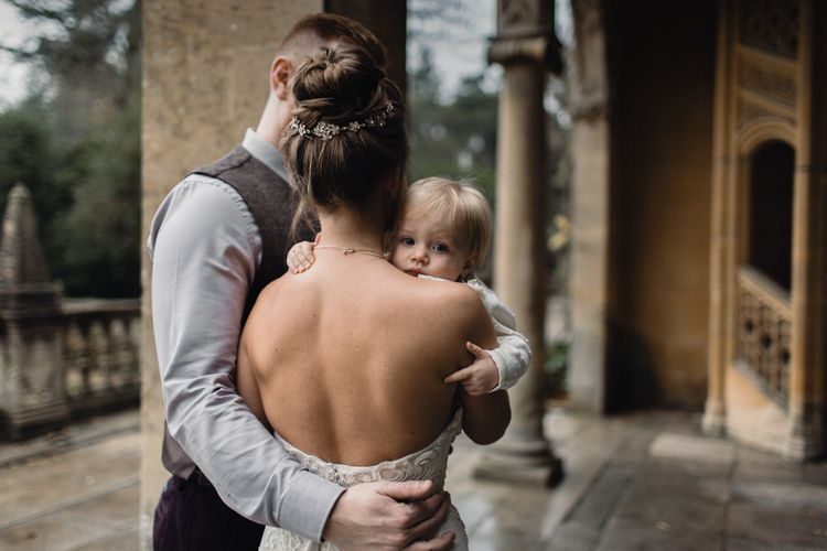 Bride & Groom With Daughter // Christmas Pub Wedding At The Falcon Rotherwick With Bride In Alice By Watters And Candle Lit Wedding Ceremony Images By Rebecca Searle Photography