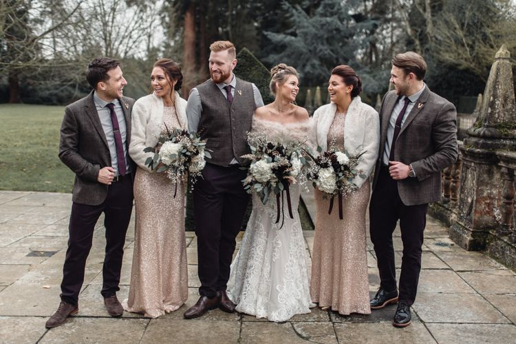 Winter Wedding Party Attire // Christmas Pub Wedding At The Falcon Rotherwick With Bride In Alice By Watters And Candle Lit Wedding Ceremony Images By Rebecca Searle Photography