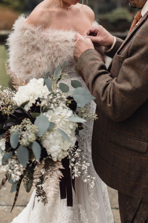 Winter Wedding Bouquet // Christmas Pub Wedding At The Falcon Rotherwick With Bride In Alice By Watters And Candle Lit Wedding Ceremony Images By Rebecca Searle Photography