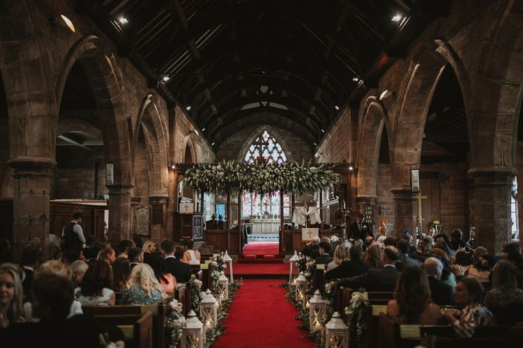 Guests Wait For Bride and Groom in Decorated Church