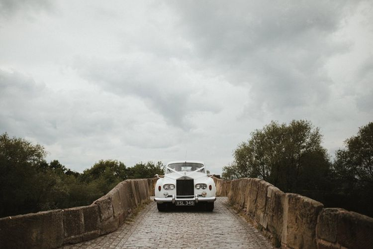 Classic Wedding Car On Way To Ceremony