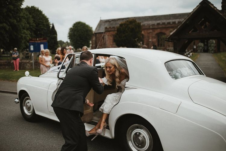 Bride Gets Out Of White Wedding Car At Church