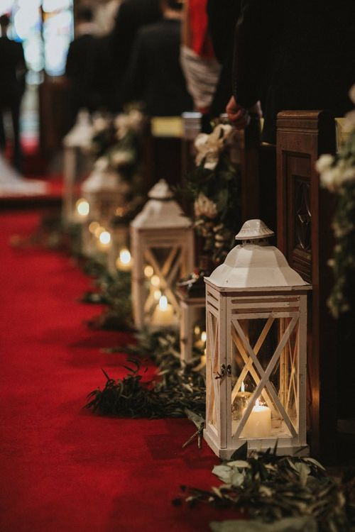 Lantern Aisle Decor With Foliage and Candles in Church