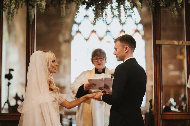 Bride and Groom Say Vows At Church Wedding