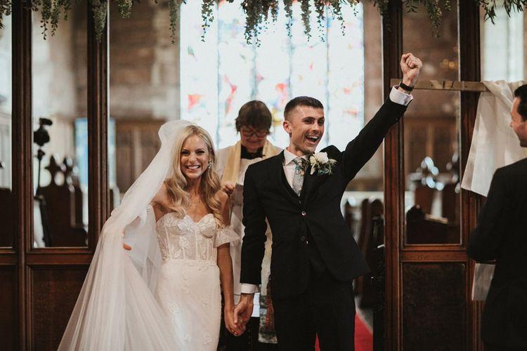 Bride and Groom Celebrate in Church