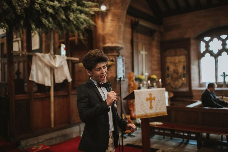 Guest Sings During Church Ceremony