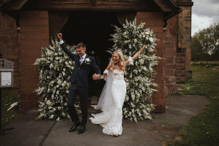 Bride and Groom Emerge As Husband and Wife