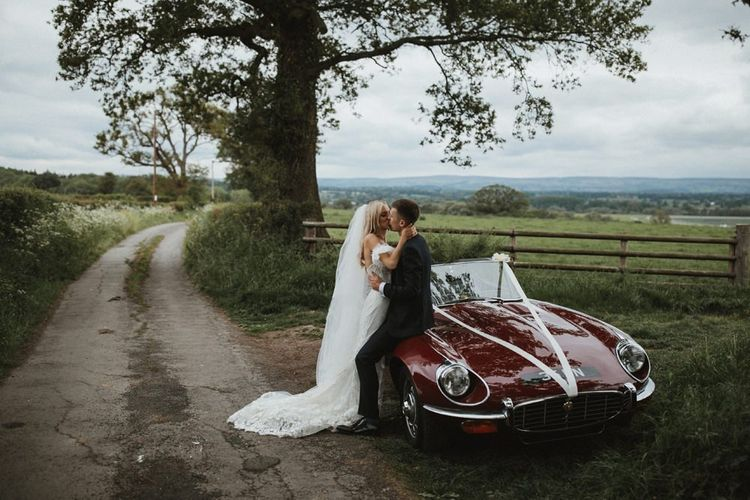 Bride And Groom Kiss On Vintage Car