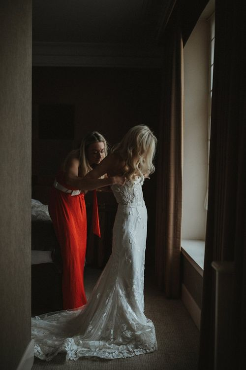 Bride Getting Into Her Emma Beaumont Dress