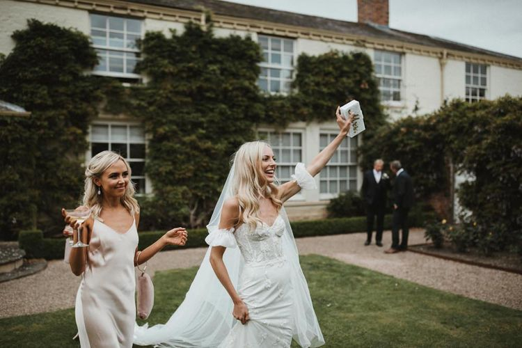 Bride Clutches Bag Saying 'Mrs'