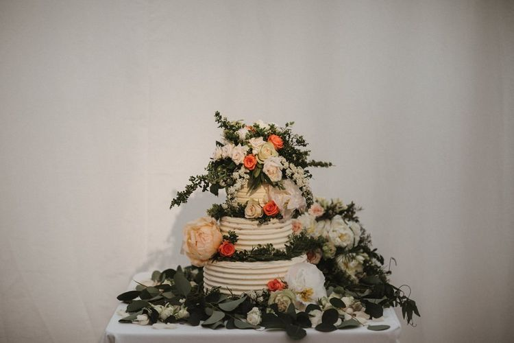 Tiered Wedding Cake Decorated with Flowers and Foliage