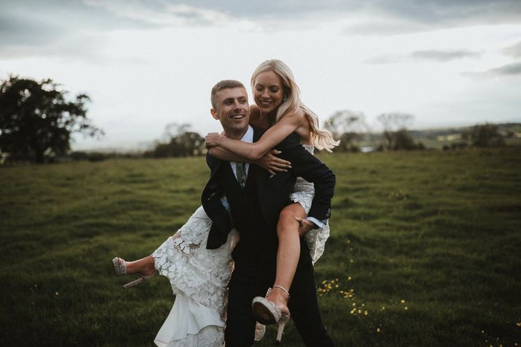 Groom Gives Piggyback To Bride Wearing Jimmy Choo Shoes