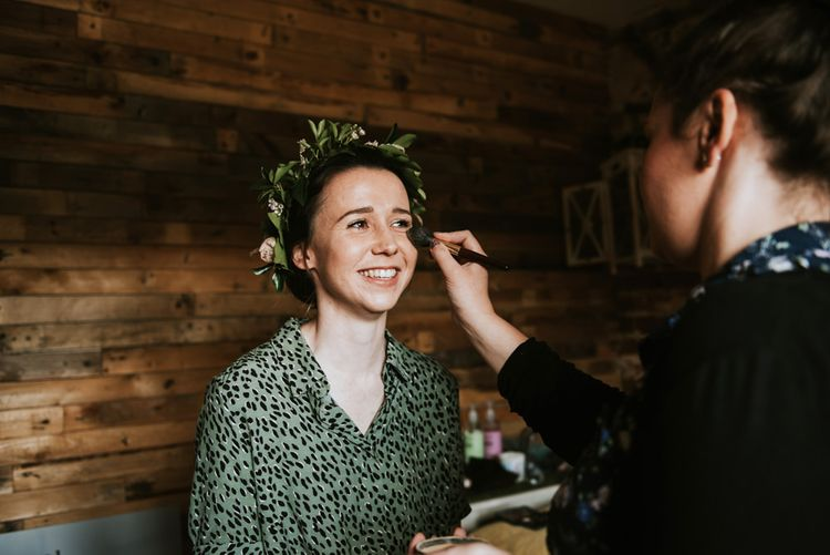 Bridal preparations for rustic outdoor wedding