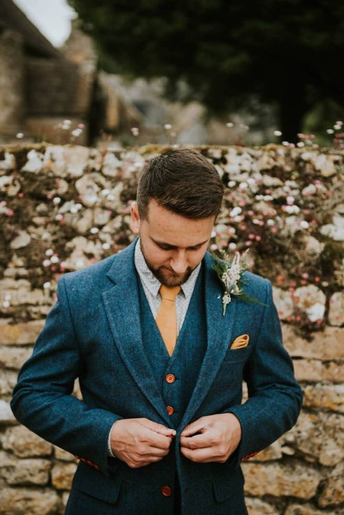 Groom in wooden suit and buttonhole