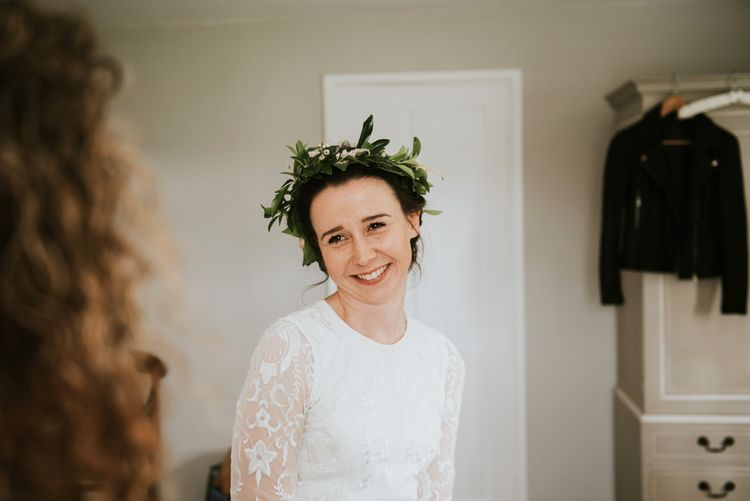 Bride in Savannah Miller wedding dress with foliage crown