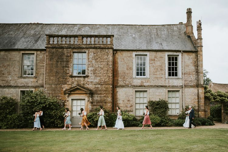 Bridal party make their way to outdoor ceremony