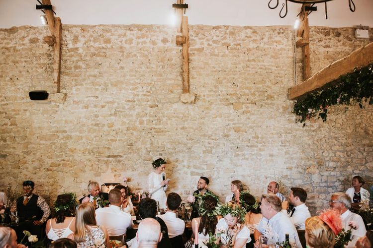 Bride in Savannah Miller wedding dress  makes wedding speech at rustic celebration