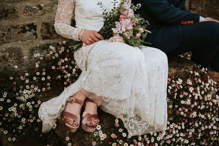 Lace Savannah Miller wedding dress with pink velvet shoes and blush bouquet