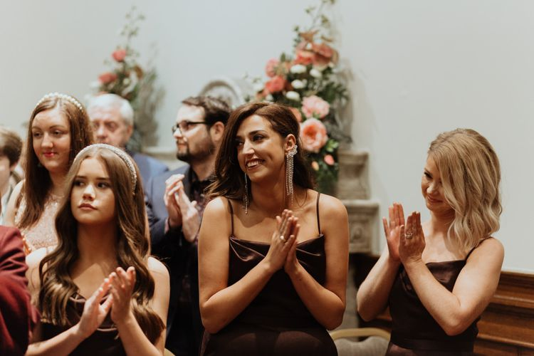 Brown bridesmaid dresses at a party wedding celebration in Liverpool