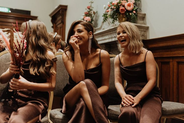Bride and groom tie the knot at an informal party celebration in Liverpool with brown bridesmaid dresses