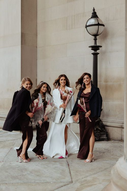 Bride and her bridal party at an informal party celebration in Liverpool with brown bridesmaid dresses and dried pampas grass bouquet