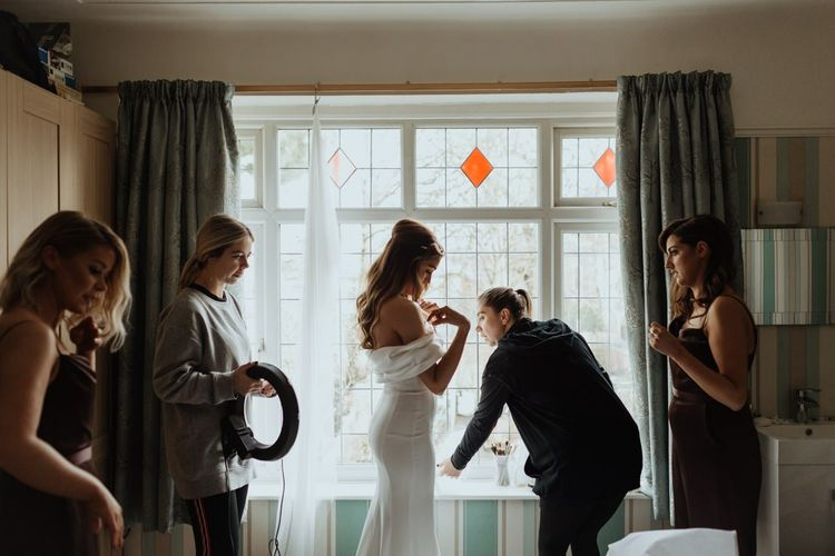 Bride getting ready for her party wedding celebration with brown bridesmaid dresses