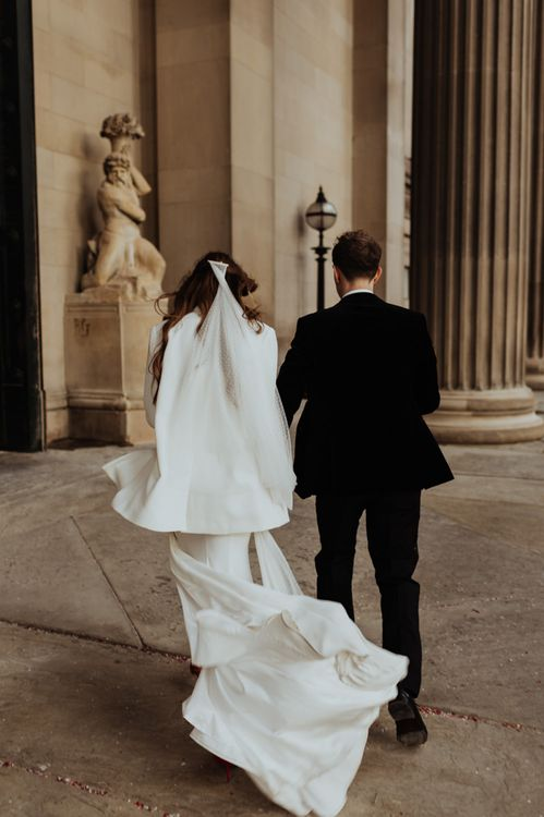 Bride and groom steal a moment at their informal December wedding in Liverpool
