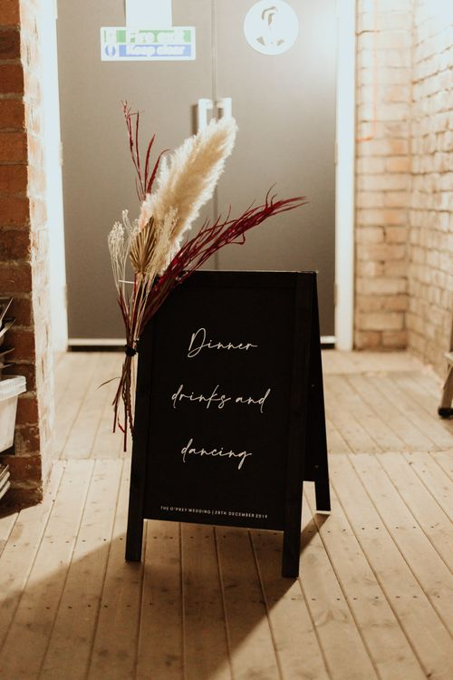 DIY wedding signs with dried pampas grass decoration and contemporary styling