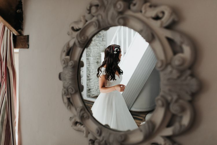 Bride in Paloma Blanca wedding dress with hair piece