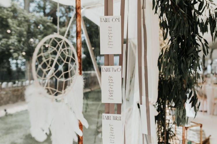 Dream catcher wedding decor with seating plan