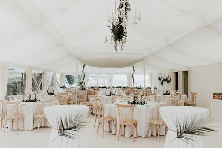 Marquee wedding with foliage decor and DIY hoops