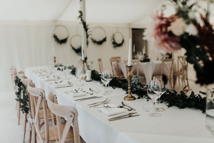 Wedding decor with foliage hoops and table runners