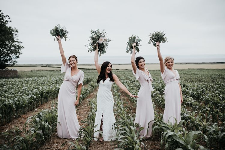 Bridal party in blush pink bridesmaid dresses