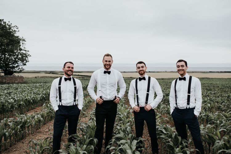 Groomsmen in matching bowties and braces