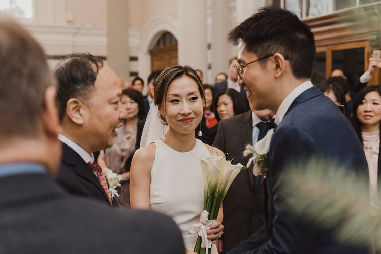 Bride and Groom Greeting Wedding Guests
