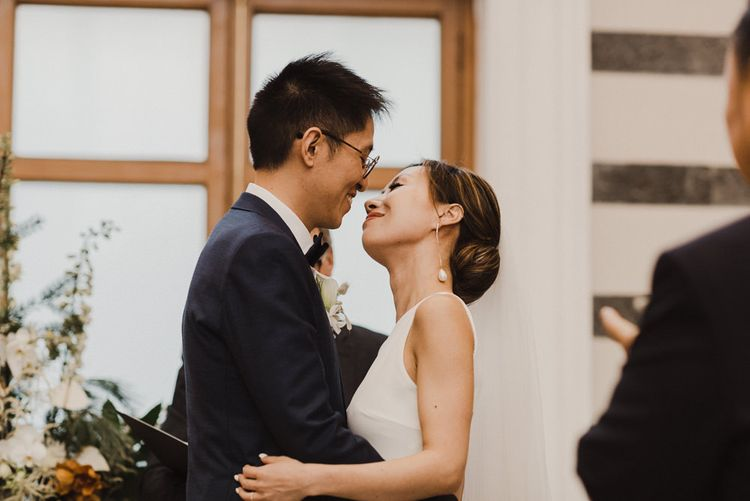 Bride and Groom Embracing at Humanist Wedding Ceremony