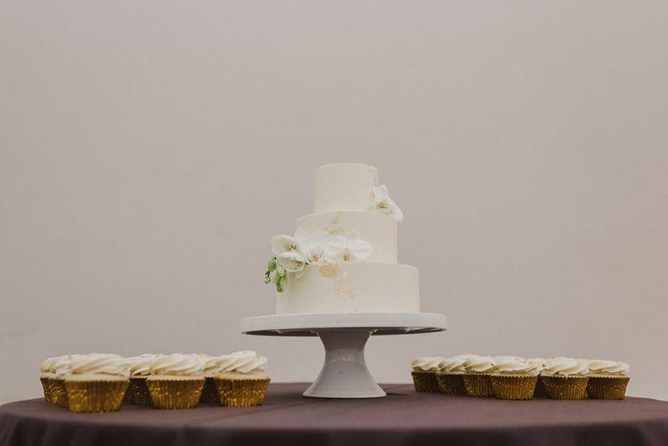 Three Tier Minimalist Wedding Cake with White Flower Decor