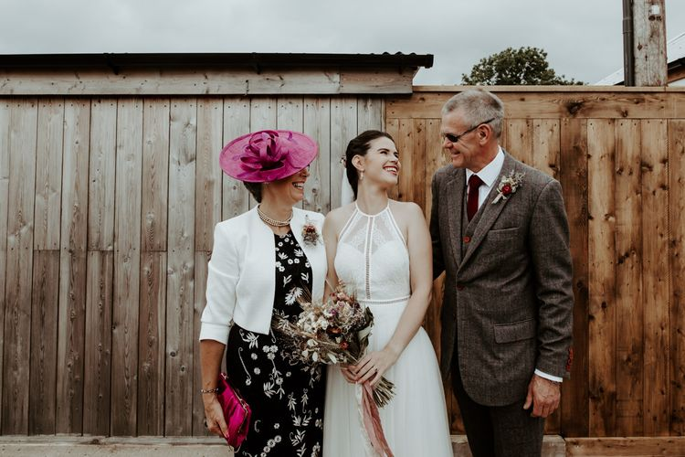 Bride in Willowby Watters wedding dress with her parents