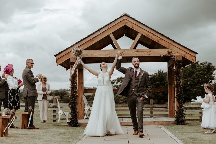 bride and groom just married at socially distanced wedding at Eden Barn