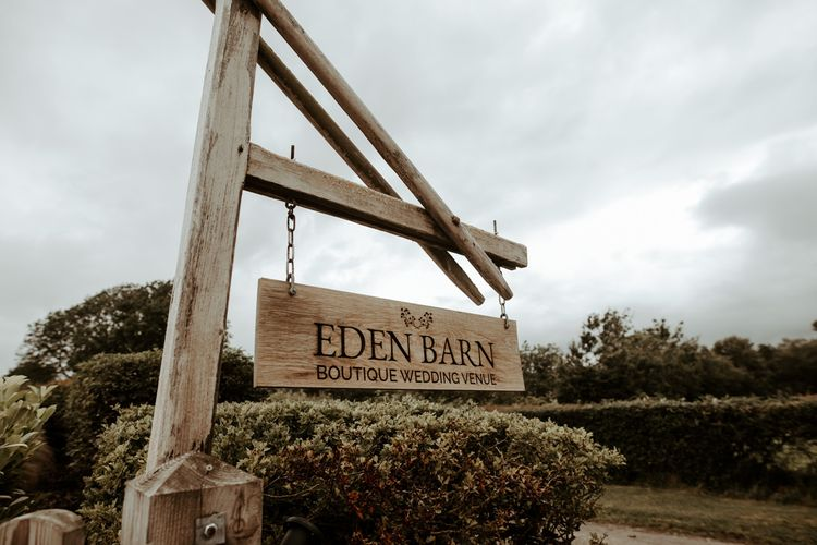 Wooden Eden Barn wedding venue sign