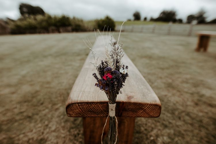 Benches with dried flowers on the ends