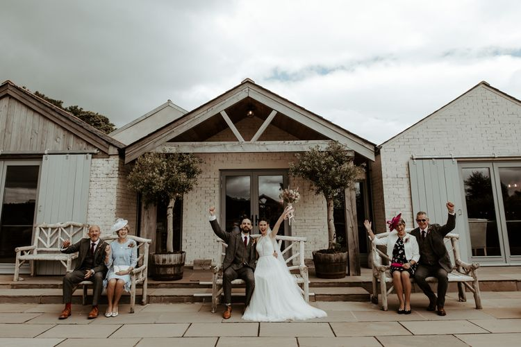 Socially distance wedding party portrait at Eden Barn by Jo Greenfield Photography