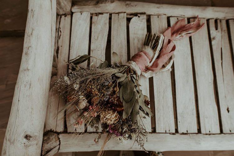 Hand tied dried flower wedding bouquet for Eden Barn wedding