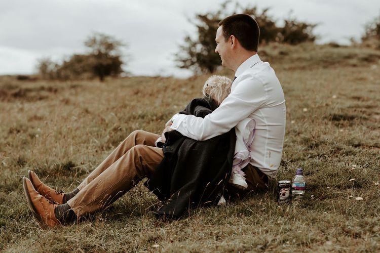 Wedding guests cradling a child at Eden Barn wedding
