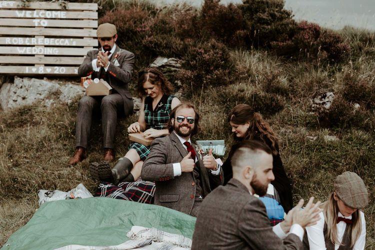 Wedding guests enjoying a picnic wedding breakfast