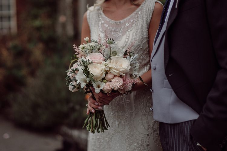 Bride wears Jenny Packham from Brides Dress Revisited | Blush Pink and White Flowers by Arcade Flowers | Traditional Wedding at Lainston House Hotel, Hampshire | RMW The List Supplier Jason Mark Harris Photography