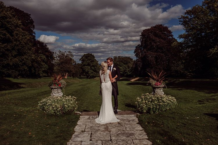 Bride wears Jenny Packham from Brides Dress Revisited | Blush Pink and White Flowers by Arcade Flowers | Groom wears Morning Suit from Buckleigh of London | Traditional Wedding at Lainston House Hotel, Hampshire | RMW The List Supplier Jason Mark Harris Photography
